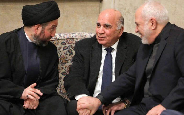 Vorsitzender der Hashd al Shaabi Faleh al-Fayyad (mi.) mit Irans Außenminister Mohammad Javad Zarif (re.)