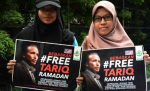 Anhängerinnen des Islamwissenschaftlers Tariq Ramadan protestieren gegen seine Verhaftung wegen Vergewaltigung