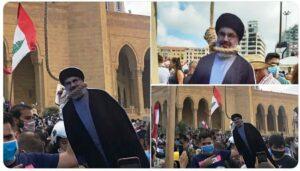 Demonstranten in Beirut hängen eine Pappfigur von Hisbollah-Chef Hassan Nasrallah. (Quelle: Twitter)