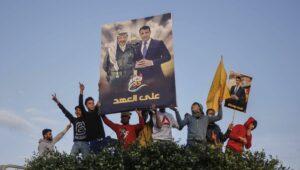Der Abbas-Rivale Dahlan (auf dem Plakat mit Arafat) lebt in den Vereinigten Arabischen Emiraten