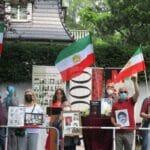 Iranische Oppositionelle in Berlin demonstrieren den Präsidentschaftskandidaten Ebrahim Raisi