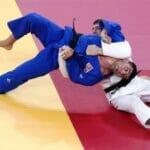 Der gebürtige Iraner Saeid Mollaei (im blauen Judoanzug) bei seinem Halbfinalkampf in Tokio gegen den Österreicher Shamil Borchashvili. (© imago images/Xinhua)